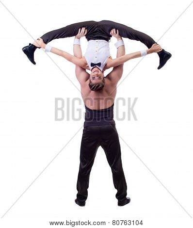 Happy female acrobat posing with her partner
