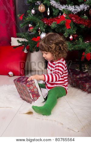 Toddler Boy Opening Christmas Gift