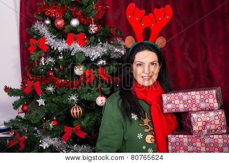 Reindeer Woman Holding Christmas Gifts