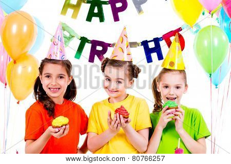 Happy smiling  girls holding colorful cakes - isolated on a white background.