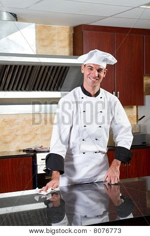 chef cleaning in kitchen