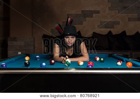 Young Woman Lying On The Billiard Table