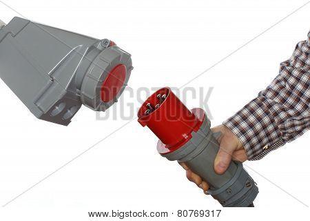 Hand Holds Electrical Plug