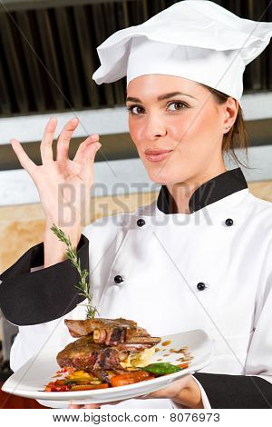 chef presenting food in kitchen