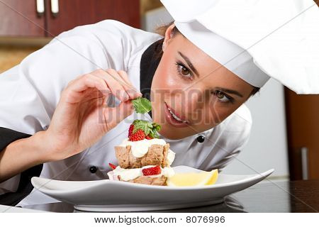 chef decorating delicious dessert