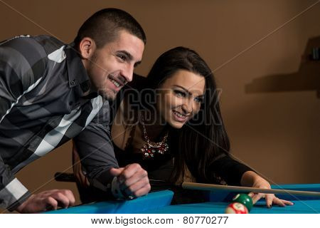 Beautiful Couple Playing Pool