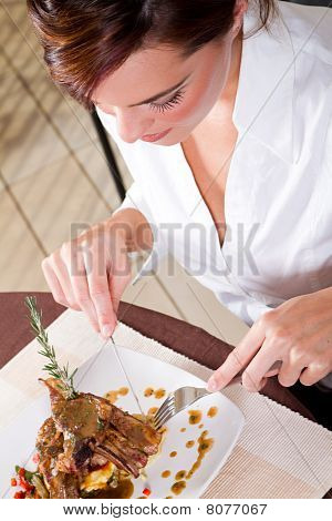 woman eating meal in restaurant