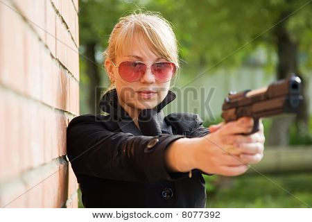 Woman Aiming Black Gun