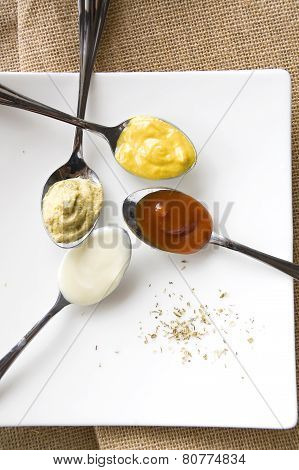 Colorful Condiments On Spoon
