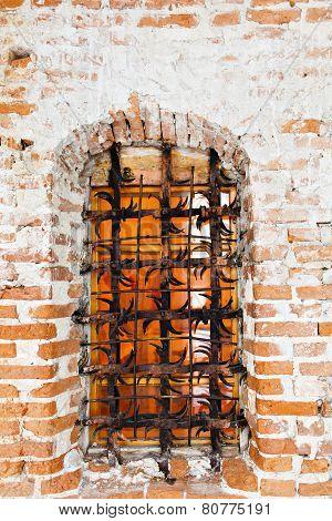 Old fort castle lattice window in brick wall