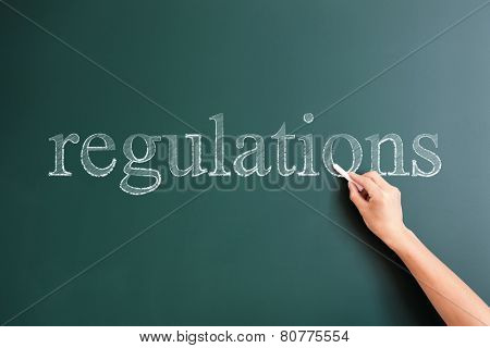 regulations written on blackboard