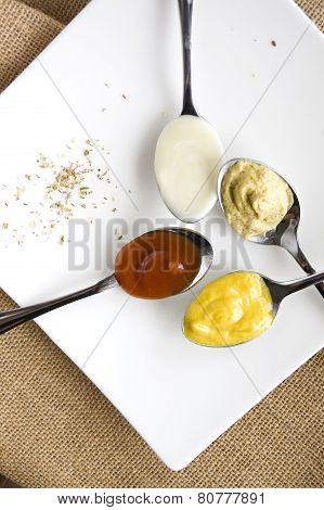 Variety Condiments On Spoon