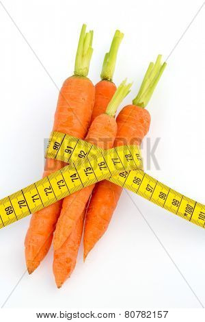 organically grown carrots with tape measure. fresh fruit and vegetables is always healthy. symbolic photo for healthy diet