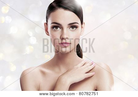 Pretty young woman with professional make-up, skin care concept