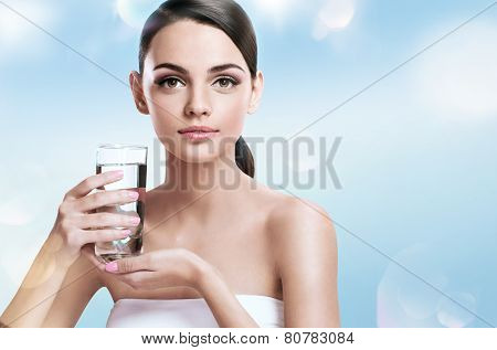 Young beautiful woman with glass of clear water, healthy life concept
