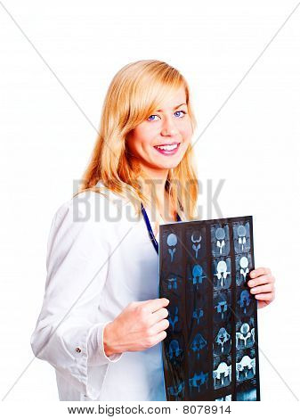 Female Doctor Examining X-ray Picture Over White
