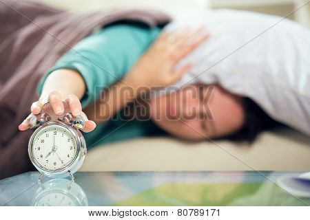 Woman's hand off the alarm clock.