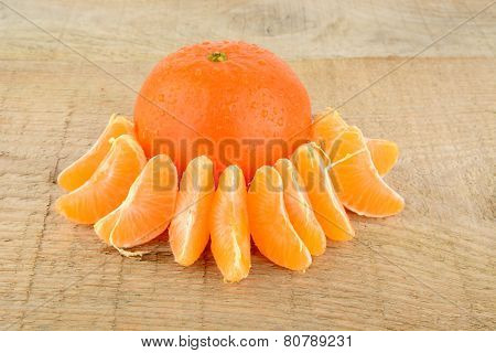 Studio Shot Pieces Dewy Mandarines On Wooden Table