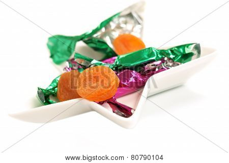 Dried apricot in a candy wrapper