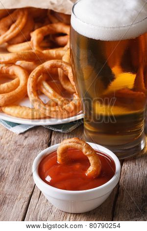 Fried Onion Rings And Beer Close-up On The Table. Vertical