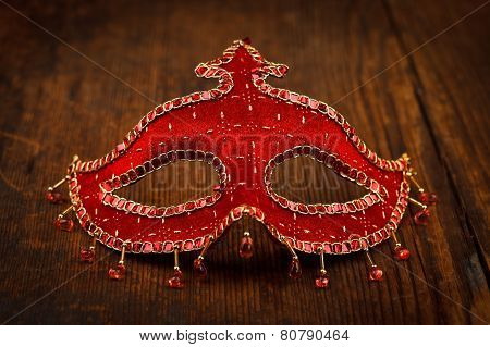 Red Carnival Mask On Wooden Table
