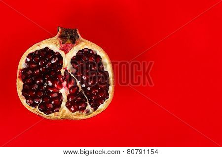Half Grenadine Over Red Background