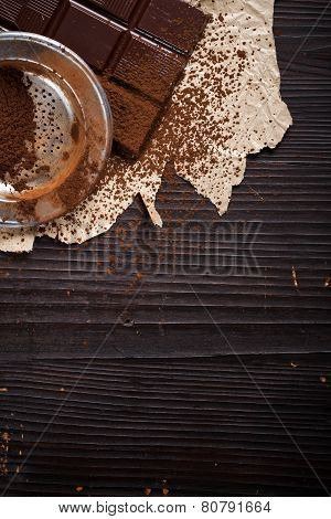Cocoa Powder With Sieve On Chocolate Bar