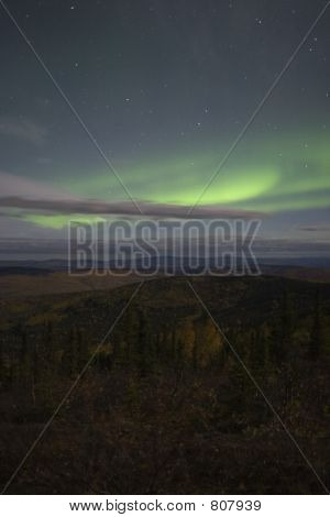 Moon lit sky with aurora over fall colors