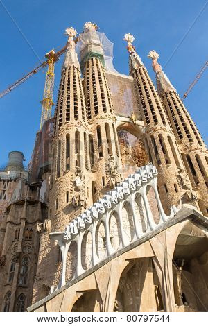 BARCELONA, SPAIN - DEC 23, 2014: La Sagrada Familia - the impressive cathedral designed by Gaudi, which is being build since Mar 19, 1882 and is not finished yet.