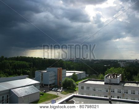 Cloudy Sky, Green Trees And Buildings