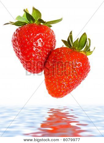 Fresh Ripe Strawberries Falling In Water