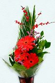 picture of gerbera daisy  - Bouquet with Daisy flower red gerbera and green leaves - JPG