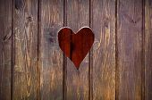 stock photo of wooden shack  - Wooden board with cut out heart shape - JPG