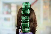 stock photo of hair curlers  - Long female hair during hair dressing with curler - JPG