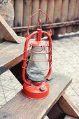 image of kerosene lamp  - Kerosene lamp on wooden stairs - JPG