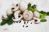 stock photo of crimini mushroom  - Champignon mushroomsherbs and spices on a white wooden background  - JPG