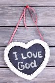 image of god  - Heart shaped chalkboard and I love God text on wooden background - JPG