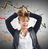 picture of collapse  - Exhausted businesswoman despairs for the financial collapse - JPG