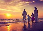 picture of children walking  - Family Walking Beach Sunset Travel Holiday Concept - JPG