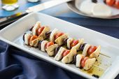 stock photo of antipasto  - Vegetarian antipasto kepbobs drizzled with olive oil and balsamic vinegar - JPG
