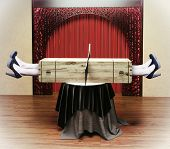 pic of sawing  - Magician sawing a woman with a saw - JPG