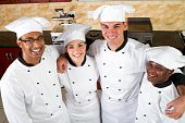 foto of catering service  - group of professional chefs in commercial kitchen - JPG