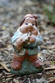 pic of  midget elves  - Garden gnome playing a saxaphone - JPG