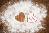 picture of home is where your heart is  - Heart of white flour on a wooden board - JPG