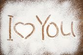 image of home is where your heart is  - Heart and I Love You words of white flour on a wooden board - JPG
