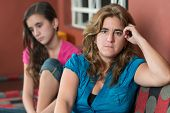 stock photo of argument  - Worried mother and her sad teenage daughter after having an argument - JPG