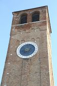 picture of roman numerals  - bell tower with large clock with Roman numerals and a single hour hand - JPG