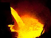 stock photo of blast-furnace  - Liquid metal from blast furnace pouring into railroad container - JPG