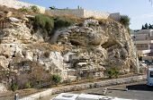 stock photo of golgotha  - Rock with the shape of a skull near the Garden Tomb in Jerusalem - JPG