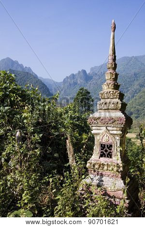Buddhist cemetery and mountains at Ban Phatang, Lao people democratic republic